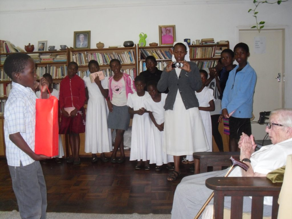 The children making a presentation to Sr Christopher